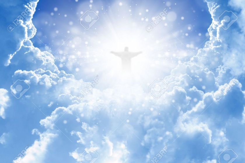 15070803-Jesus-Christ-in-blue-sky-with-clouds-heaven-Stock-Photo